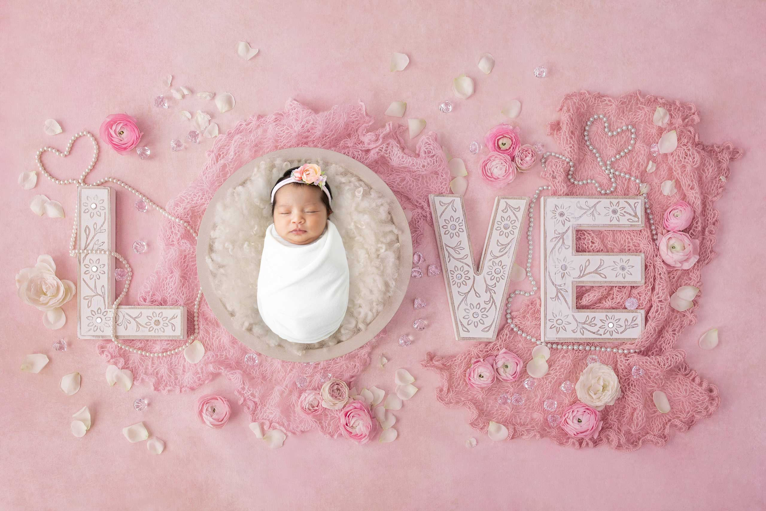 baby newborn love photograph taken in Los Angeles by Ramina Magid Photography