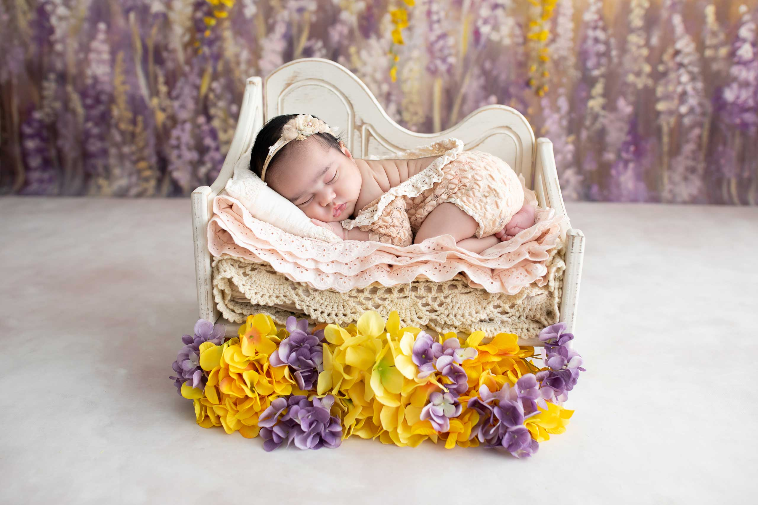 baby newborn photograph with flowers taken in Los Angeles by Ramina Magid Photography