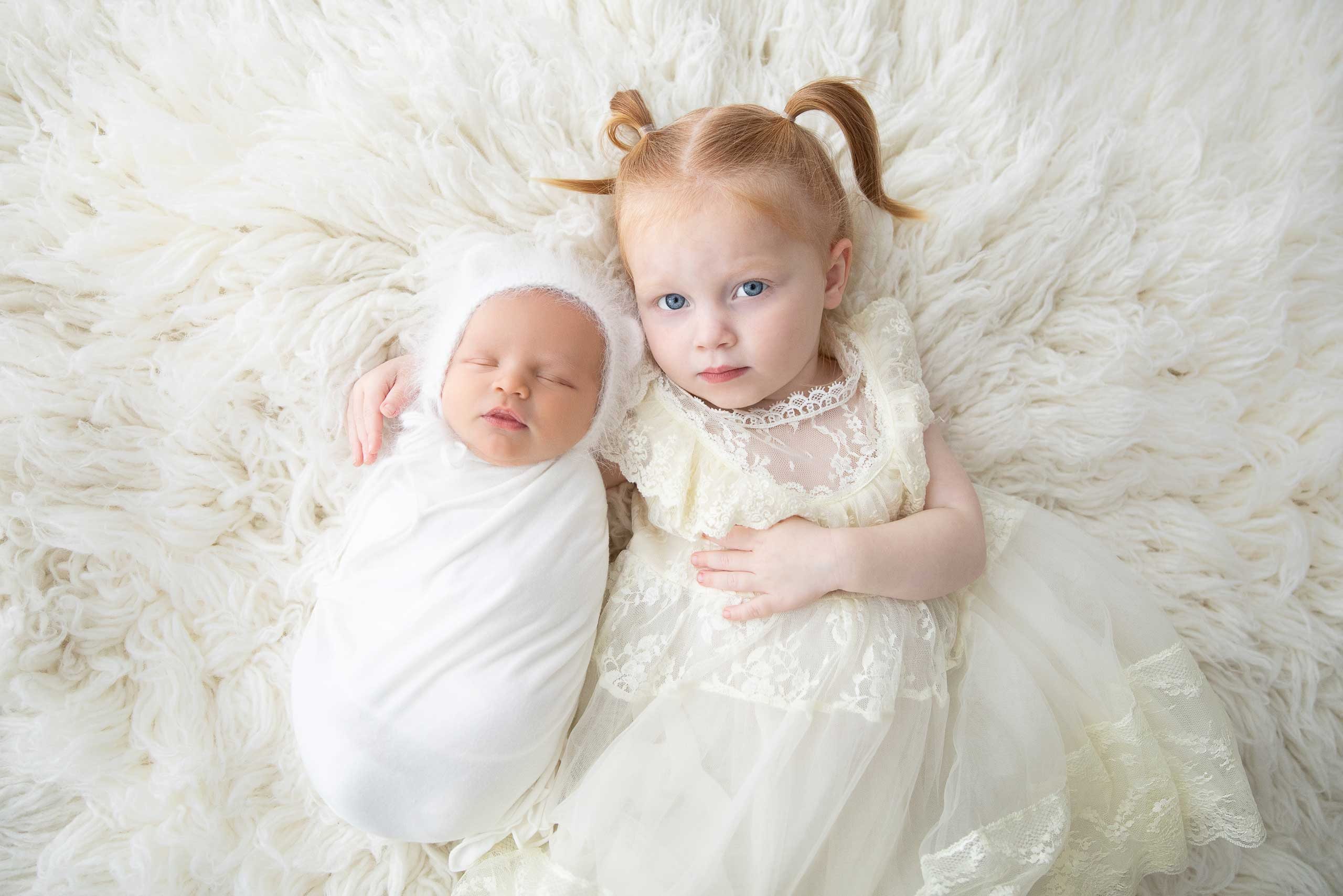 baby newborn and sister photograph taken in Los Angeles by Ramina Magid Photography