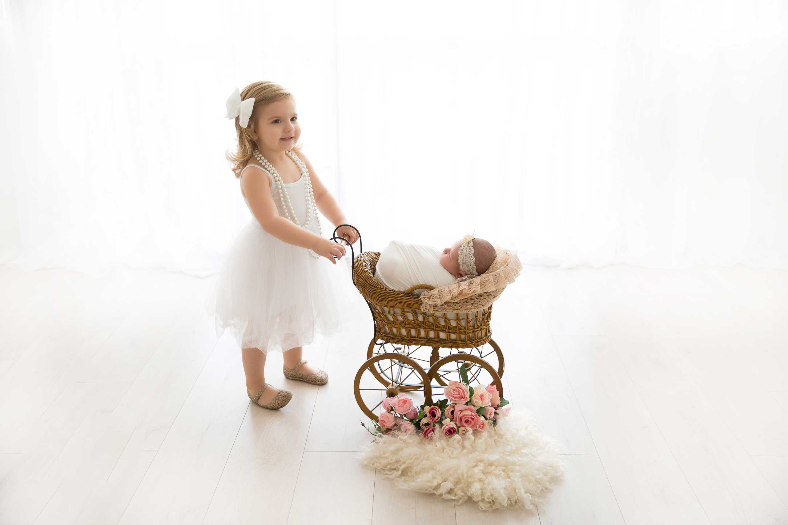 newborn photo session taken by Ramina Magid Photography in Los Angeles. Baby in the stroller